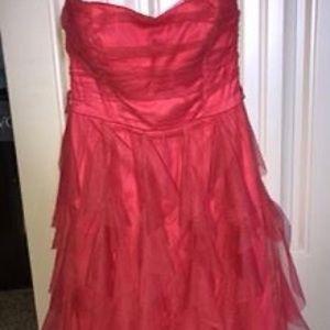 2 prom dresses. coral, size 3, black size 5.